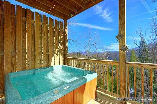 lower level deck with hot tub at tranquil view a 1 bedroom cabin rental located in gatlinburg