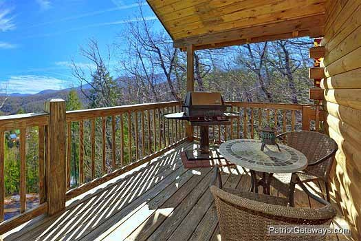 main level deck with grill at tranquil view a 1 bedroom cabin rental located in gatlinburg