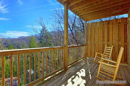 main level deck with rockers at tranquil view a 1 bedroom cabin rental located in gatlinburg