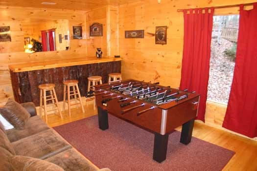 Wet bar behind foosball table at Dragonfly, a 2-bedroom cabin rental located in Gatlinburg