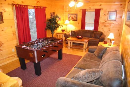 game room with two sofa beds at dragonfly a 2 bedroom cabin rental located in gatlinburg