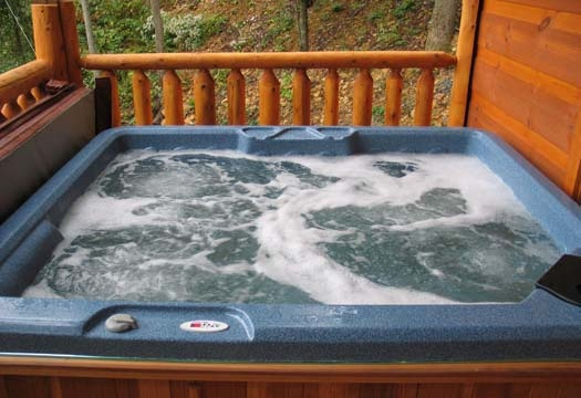 hot tub on deck at dragonfly a 2 bedroom cabin rental located in gatlinburg
