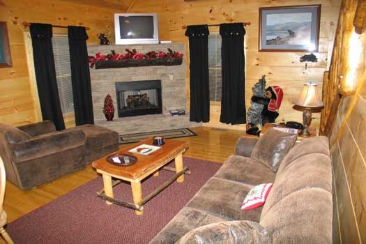living room with stone fireplace at dragonfly a 2 bedroom cabin rental located in gatlinburg