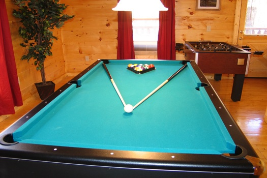 Green felted pool table in game room at Dragonfly, a 2-bedroom cabin rental located in Gatlinburg