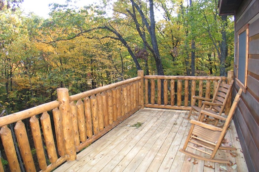 Rocking chairs on the deck at Dragonfly, a 2-bedroom cabin rental located in Gatlinburg