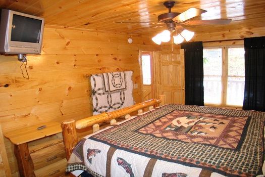 TV in the corner of the bedroom at Dragonfly, a 2-bedroom cabin rental located in Gatlinburg