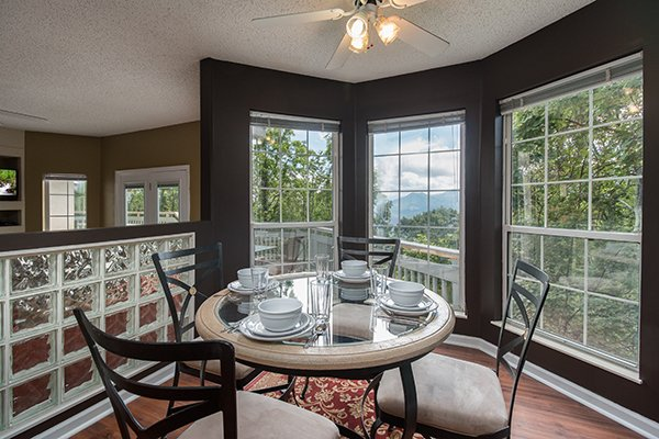 Breakfast nook with seating for four at Castle on the Hill, a 2-bedroom cabin rental located in Gatlinburg