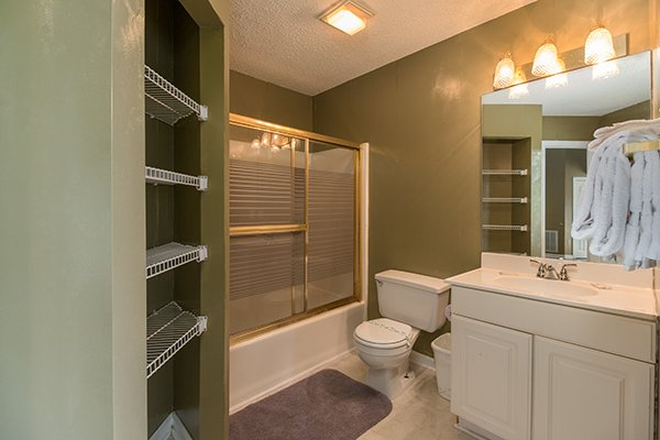 Bathroom with a tub and shower at Castle on the Hill, a 2-bedroom cabin rental located in Gatlinburg