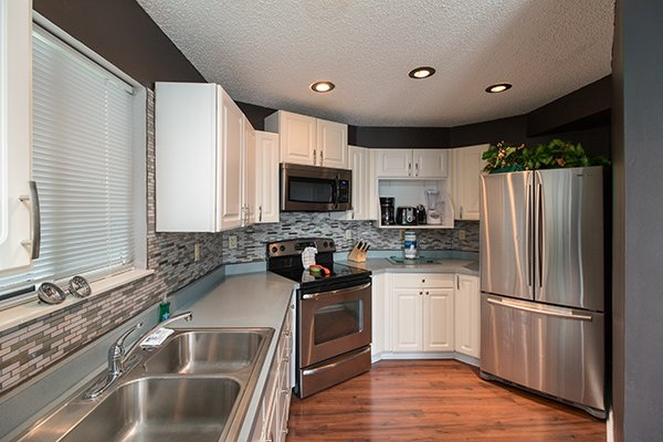 Kitchen with stainless steel appliances at Castle on the Hill, a 2-bedroom cabin rental located in Gatlinburg