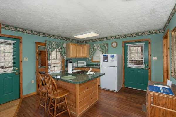 Kitchen with island at Hideaway, a 1 bedroom cabin rental located in Pigeon Forge