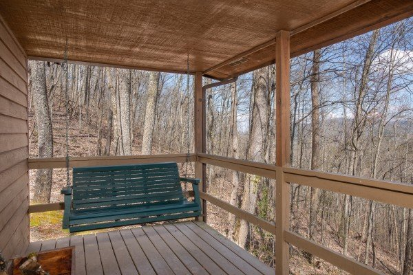 Porch swing and winter mountain views at Hideaway, a 1 bedroom cabin rental located in Pigeon Forge