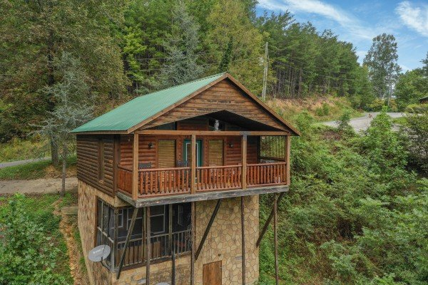 Rear exterior of the cabin built into the hillside at Paradise View, a 1 bedroom cabin rental located in Pigeon Forge