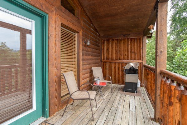 Deck seating near privacy fence at Paradise View, a 1 bedroom cabin rental located in Pigeon Forge