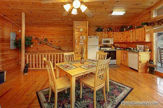 Dining and kitchen area at Paradise View, a 1 bedroom cabin rental located in Pigeon Forge