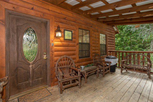 Covered front porch at Paradise View, a 1 bedroom cabin rental located in Pigeon Forge
