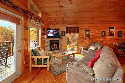 Living room with fireplace at Paradise View, a 1 bedroom cabin rental located in Pigeon Forge