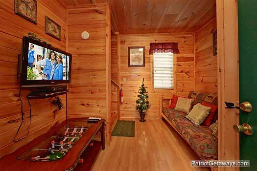 Lower level with foosball and futon at Paradise View, a 1 bedroom cabin rental located in Pigeon Forge