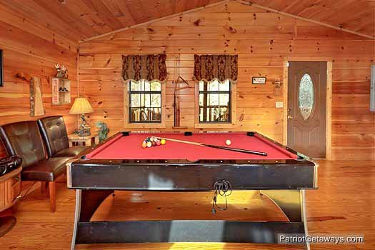Pool table at main level at Paradise View, a 1 bedroom cabin rental located in Pigeon Forge