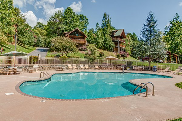 pool in a resort setting at alpine sunset thrill a 1 bedroom cabin rental located in pigeon forge
