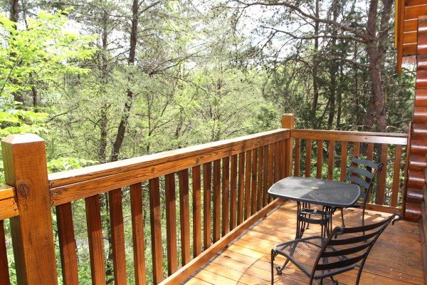 bistro set on the deck at alpine sunset thrill a 1 bedroom cabin rental located in pigeon forge