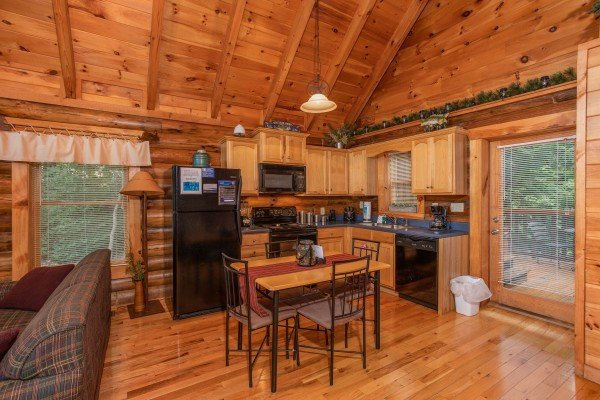eat in kitchen with seating for four at alpine sunset thrill a 1 bedroom cabin rental located in pigeon forge