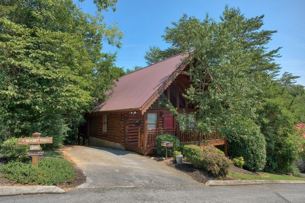 exterior of cabin with paved parking at alpine sunset thrill a 1 bedroom cabin rental located in pigeon forge
