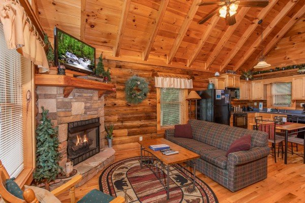 living room sofa seating near the fireplace at alpine sunset thrill a 1 bedroom cabin rental located in pigeon forge