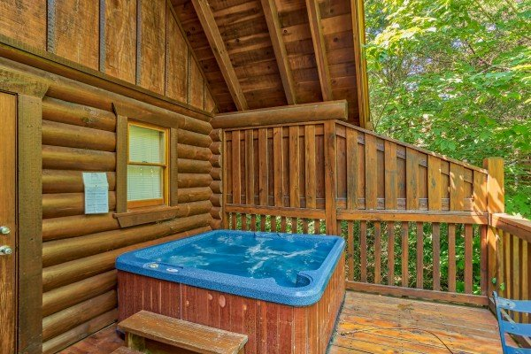 hot tub on the deck with a privacy fence at alpine sunset thrill a 1 bedroom cabin rental located in pigeon forge