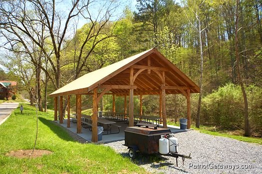 large picnic shelter with picnic tables in resort setting at alpine sunset thrill a 1 bedroom cabin rental located in pigeon forge