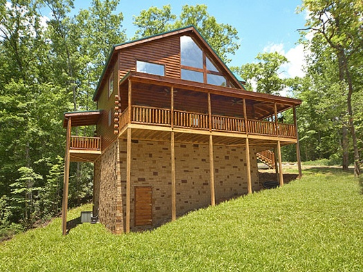 exterior back view at pool house a 2 bedroom cabin rental located in gatlinburg