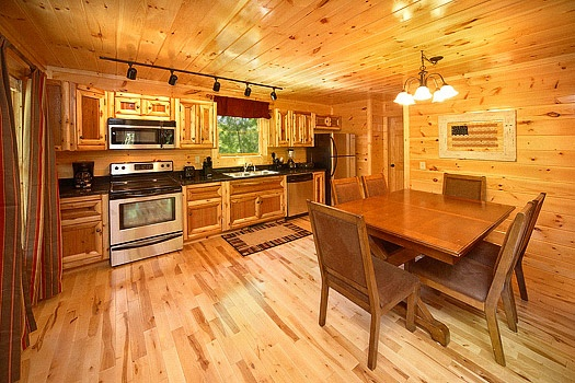 kitchen and dining area at pool house a 2 bedroom cabin rental located in gatlinburg