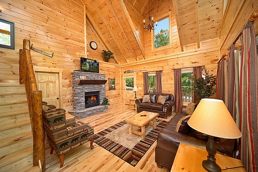 living room with fireplace at pool house a 2 bedroom cabin rental located in gatlinburg