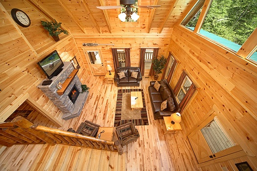 loft view of living room at pool house a 2 bedroom cabin rental located in gatlinburg