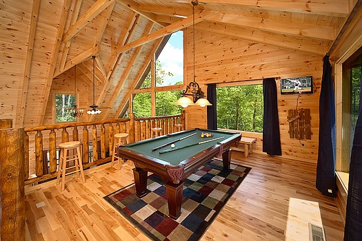 lofted game room with pool table at pool house a 2 bedroom cabin rental located in gatlinburg