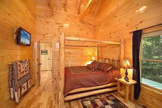second level bedroom with queen bed at pool house a 2 bedroom cabin rental located in gatlinburg
