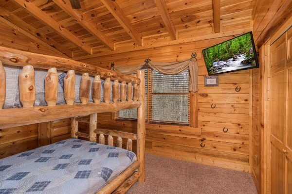 Bunk room with a television at Mountain View Meadows, a 3 bedroom cabin rental located in Pigeon Forge