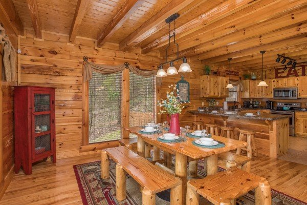 Dining table for six and kitchen with counter seating for four at Mountain View Meadows, a 3 bedroom cabin rental located in Pigeon Forge
