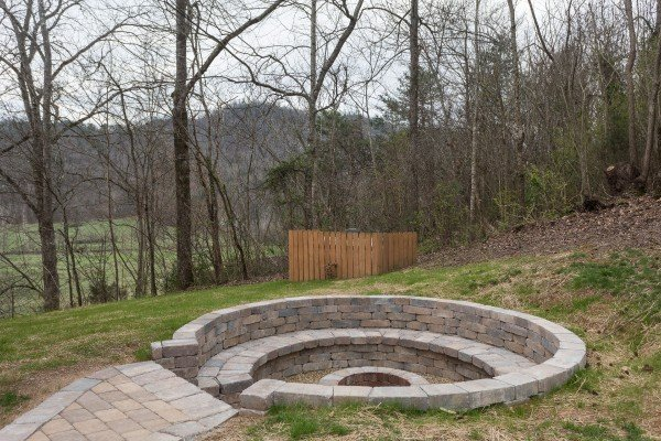 Custom stone work fire pit at Mountain View Meadows, a 3 bedroom cabin rental located in Pigeon Forge