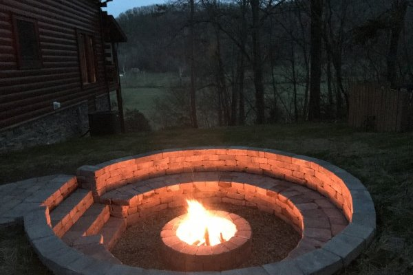 Fire pit at night at Mountain View Meadows, a 3 bedroom cabin rental located in Pigeon Forge