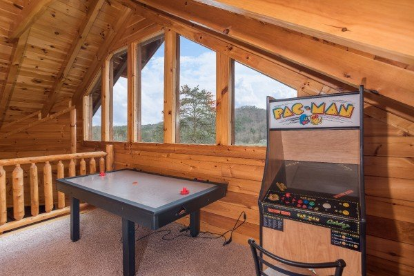 Air hockey table and a PacMan game at Mountain View Meadows, a 3 bedroom cabin rental located in Pigeon Forge