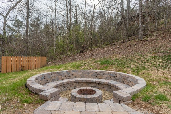 Fire pit built into the hillside at Mountain View Meadows, a 3 bedroom cabin rental located in Pigeon Forge