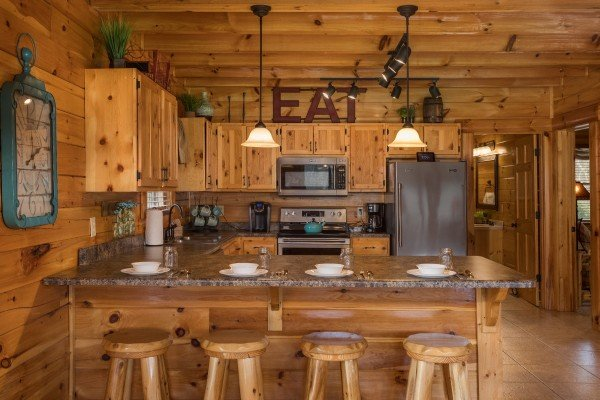 Counter seating for four off the kitchen at Mountain View Meadows, a 3 bedroom cabin rental located in Pigeon Forge