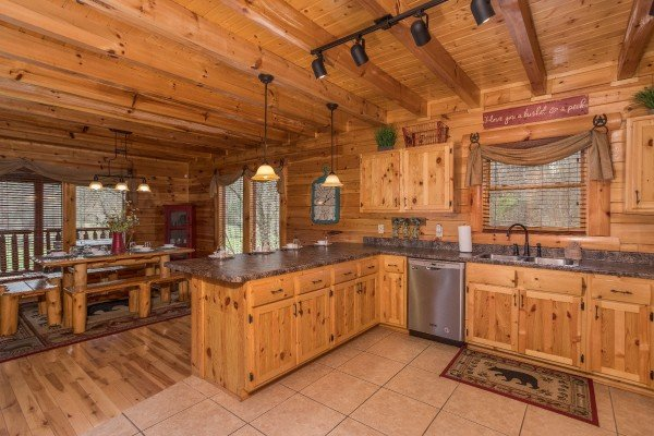 Kitchen with stainless appliances and dining space for six at Mountain View Meadows, a 3 bedroom cabin rental located in Pigeon Forge