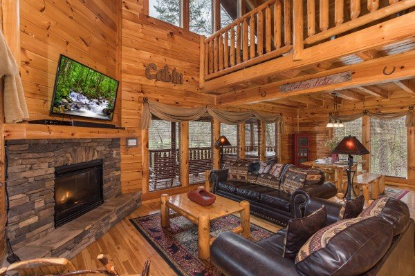 Living room with fireplace and TV at Mountain View Meadows, a 3 bedroom cabin rental located in Pigeon Forge
