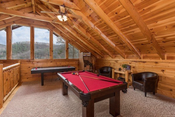 Pool table and air hockey table in the game loft at Mountain View Meadows, a 3 bedroom cabin rental located in Pigeon Forge