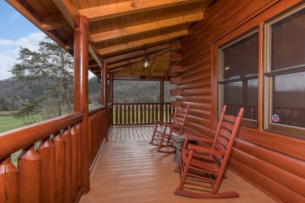 Rocking chairs on the covered deck at Mountain View Meadows, a 3 bedroom cabin rental located in Pigeon Forge