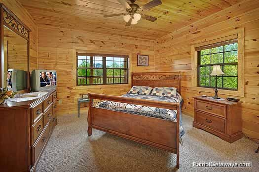 corner bedroom with queen bed at winter wonderland a 3 bedroom cabin rental located in pigeon forge