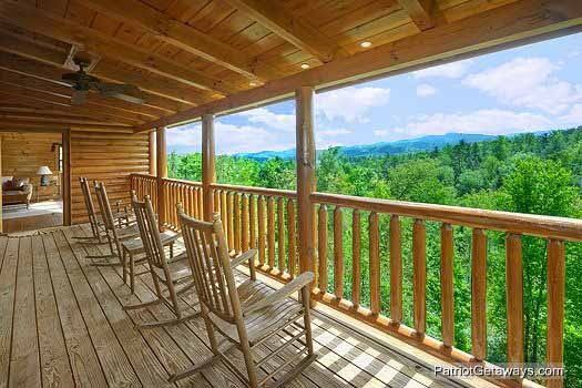 Deck with rockers at Winter Wonderland, a 3 bedroom cabin rental located in Pigeon Forge