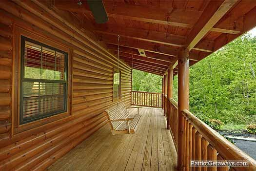 Front porch with swing at Winter Wonderland, a 3 bedroom cabin rental located in Pigeon Forge