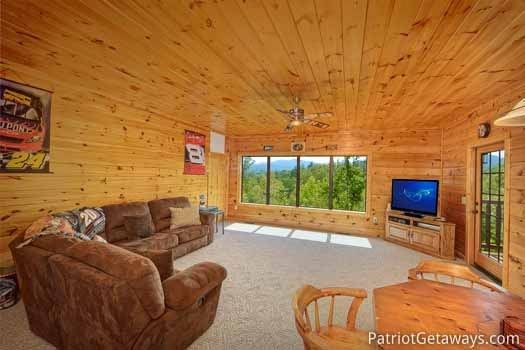 Game room with tv at Winter Wonderland, a 3 bedroom cabin rental located in Pigeon Forge